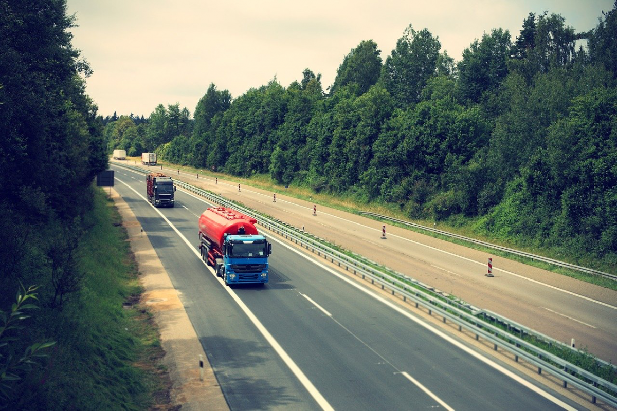 truck driving on the road moving shipments