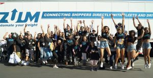 zuum transportation employee group picture jumping